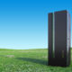 Modern Server Rack on a Beautiful green landscape with clear blue sky stock photo